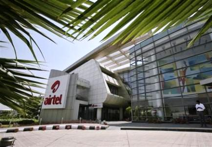 An employee stands in front of the Bharti Airtel zonal office building in Chandigarh.