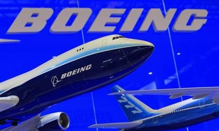 Models of Boeing 747 and 777 passenger planes are displayed at the Boeing booth.