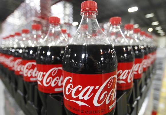 Bottles of Coca-Cola are seen in a warehouse.