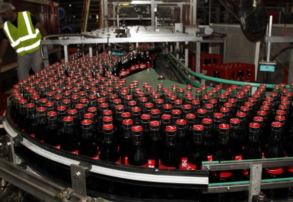 Bottles of Coca-Cola are seen on the production line at their bottling plant.