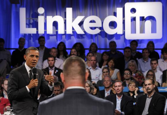 US President Barack Obama speaks to a participant who asked him a question during in a LinkedIn town hall-style meeting.