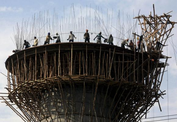 Labourers work on the construction of a water tank in Jammu.