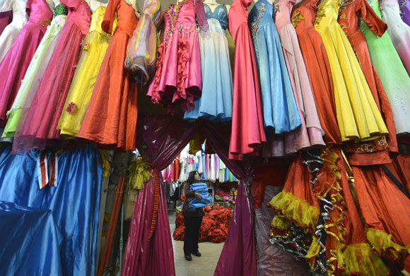 A vendor arranges clothes at a garments market in Taiyuan.