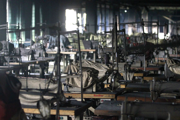 The interior of a garment factory is seen after a fire.