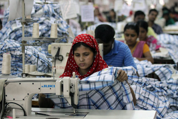 A worker sews inside a garment factory in Bangladesh.