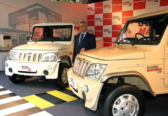 Pravin Shah, Chief Executive, Automotive Division, Mahindra & Mahindra, with newly launched trucks.