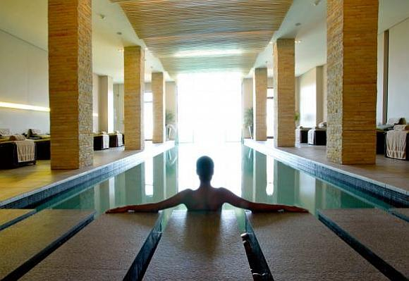 A woman relaxes in a spa.