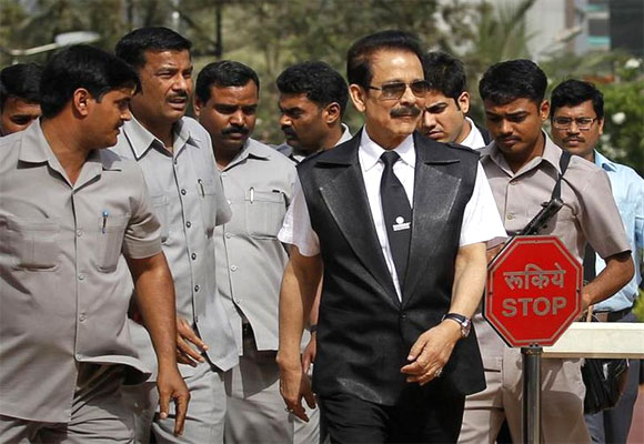 Subrata Roy accompanied by his security leaves the Sebi headquarters in Mumbai.