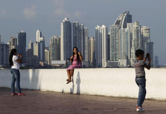 People are seen in Plaza de Francia in Panama City.