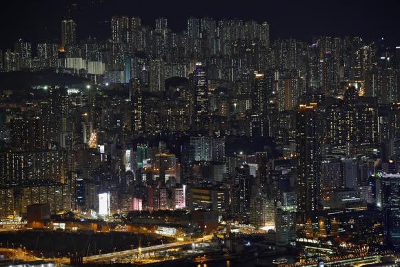 Public and private residential blocks are seen on a hillside in Hong Kong.
