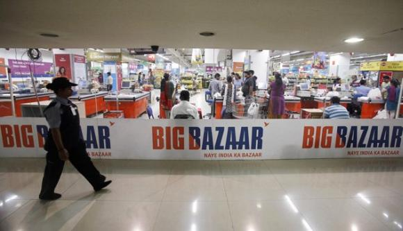 A security personnel walks past the Big Bazaar retail store in Mumbai.