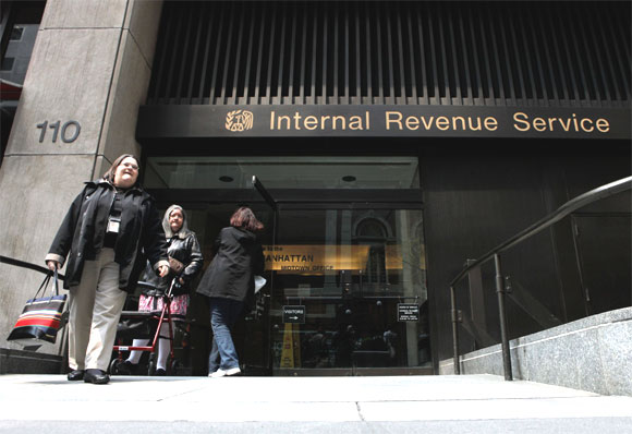 Women walk out of an Internal Revenue Service office in New York.