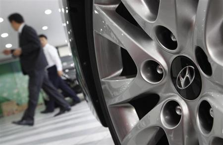 The logo of Hyundai Motor is seen on the wheel of a car at a Hyundai dealership in Seoul.