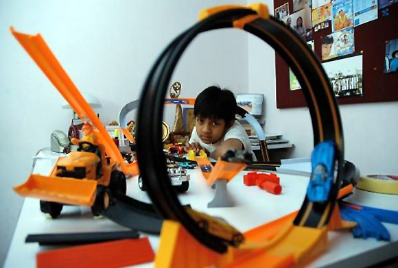 Kishan S.S. plays with toys at home in Bengaluru.