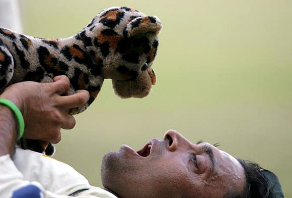 Pakistan's Shoaib Akhtar holds a stuffed toy at the end of the fourth day's play of their third and final test cricket match against India in Bangalore.