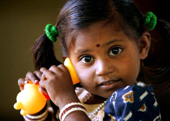 Two-year-old Sneha plays with a toy at a government centre for tsunami orphans in Nagapattinam, in southern India.