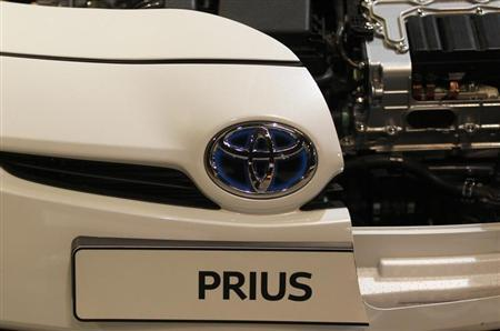 A logo of a Toyota Prius car is pictured at an exhibition stand of the 'International CAR Symposium' in Bochum.