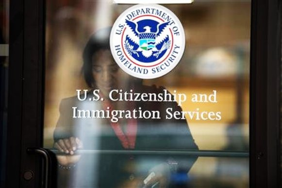 A woman leaves the U.S. Citizenship and Immigration Services offices in New York.