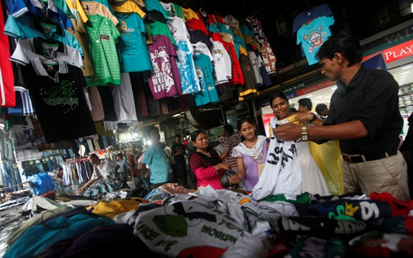 People shop for clothes at a roadside market in Kolkata.