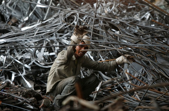 A labourer works inside a steel factory on the outskirts of Jammu.