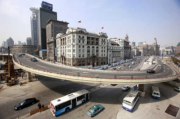 Traffic flows on a flyover at the Bund in Shanghai, China.