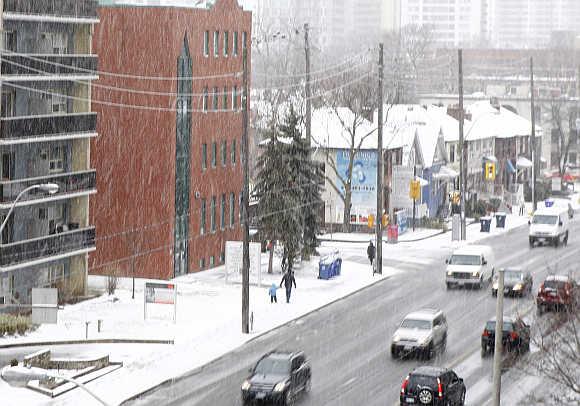 Light snow falls over Toronto, Ontario, Canada.