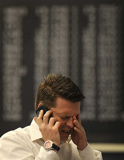 A share trader reacts at the German DAX stock exchange in Frankfurt, Germany.