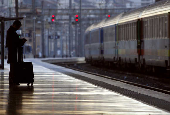 A commuter waits for a train at the Marseille's railway station in France.