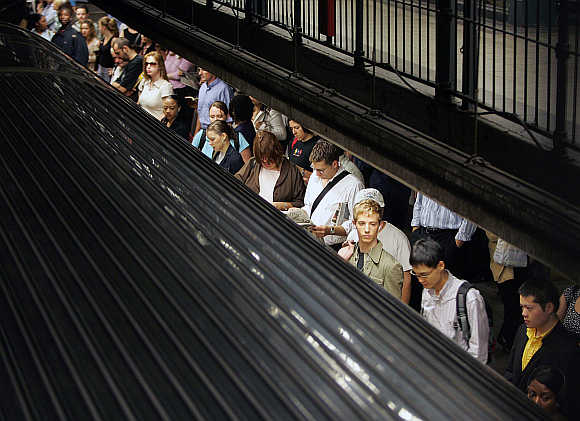 Commuters wait for a subway train in New York City, United States.