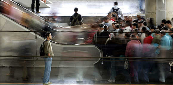 Thousands of commuters pack the Bras train station during rush hour in downtown Sao Paulo, Brazil.