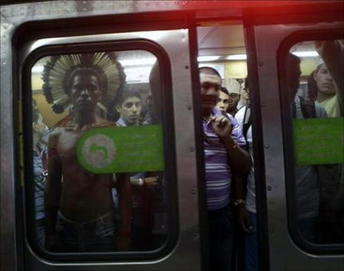 An indigenous man stands in a subway train in Rio de Janeiro.