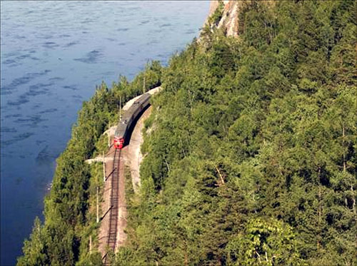 A train moves along the Trans-Siberian Railway through the Taiga district, some 90 km (56 miles) southwest of Russia's Siberian city of Krasnoyarsk.