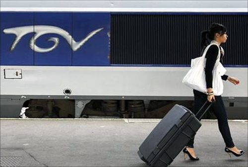 A commuter walks on a TGV train platform at Nantes's railway station.