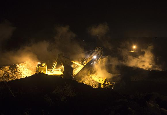 A truck is loaded with top soil at the Jharia burning coal field at Dhanbad district.