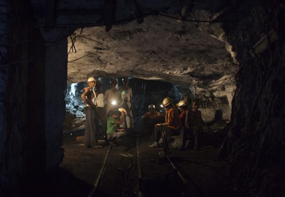 Miners rest inside an underground Barora coal mine at Dhanbad district.