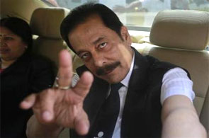Sahara Group Chairman Subrata Roy gestures as he arrives at SEBI headquarters.