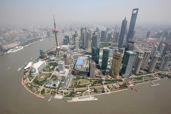 An aerial view shows Shanghai's financial district skyline along the Huang Pu river in China.