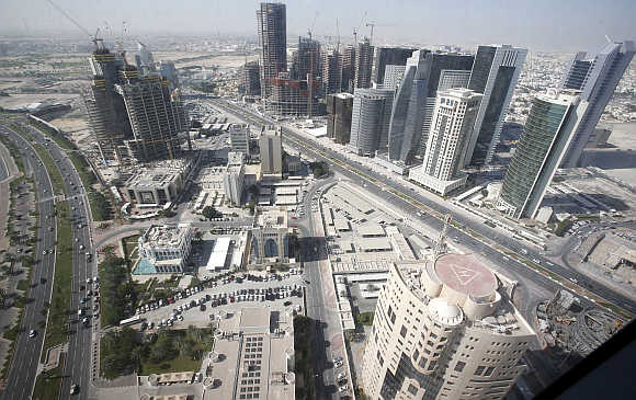 A view of Doha with buildings under construction in Qatar.