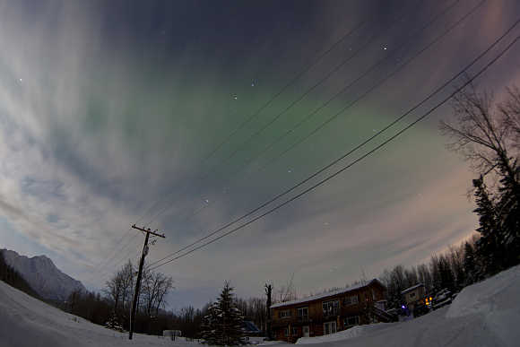 Aurora Borealis is pictured above a house along the Old Glenn Highway, Alaska, United States.