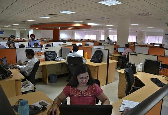 Employees work at an IT outsourcing company in Bangalore.