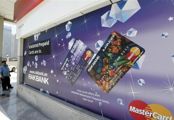 A sign displaying ATM prepaid cards is seen at a RAKBANK branch at Dubai Marina.