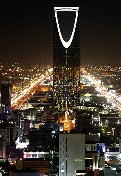 Kingdom Tower stands in the night in Riyadh.