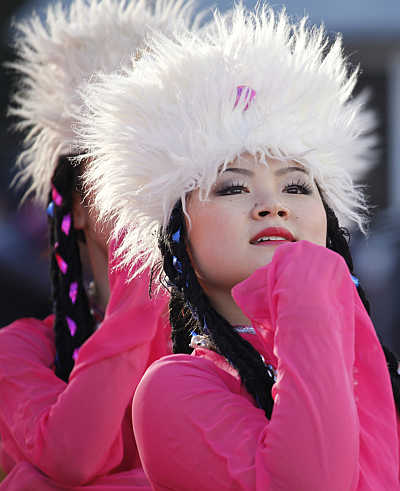 Women perform during the opening ceremony of the temple fair at Ditan Park in Bejing, China.