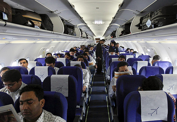 Passengers sit inside an Indigo Airlines A320 aircraft before it takes off from Bengaluru International Airport.