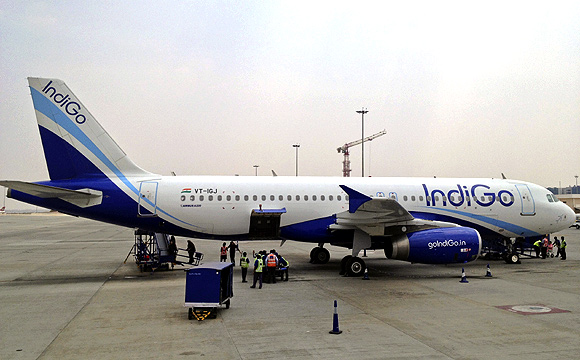 An IndiGo Airlines A320 aircraft is parked on the tarmac.