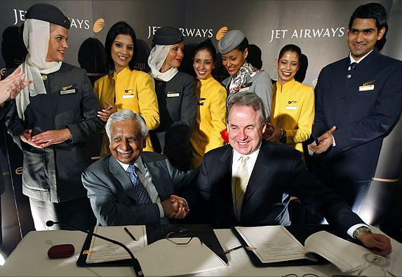 India's Jet Airways Chairman Naresh Goyal (L) and James Hogan (R) of United Arab Emirates Etihad Airways shake hands.