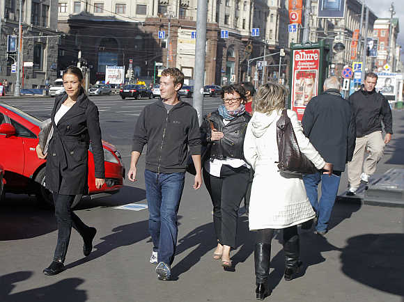 Facebook CEO Mark Zuckerberg, second left, walks on his way from a cafe to a hotel in Tverskaya Street in central Moscow, Russia.