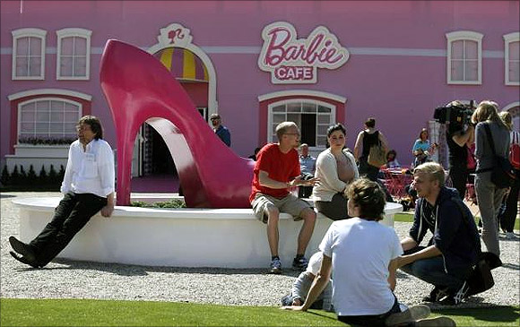 People relax outside the Barbie Dreamhouse.