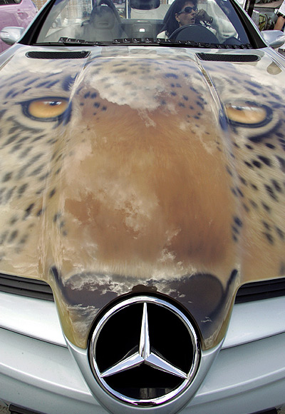 A person sits in a car during an airbrush car art show in Moscow.