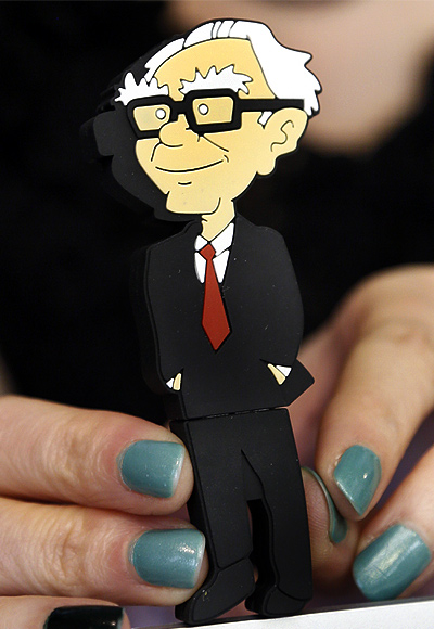 A Berkshire Hathaway souvenir USB memory stick cartoon figure of Berkshire Hathaway CEO Warren Buffett is for sale at a cocktail reception hosted by Berkshire-owned Borsheim's jewelry store on the weekend of the company's annual meeting in Omaha.